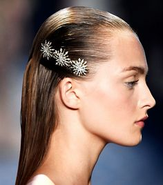 Moroccanoil global ambassador Antonio Corral Calero dressed up models' slicked-back strands with hair accessories created specifically for Jason Wu's show