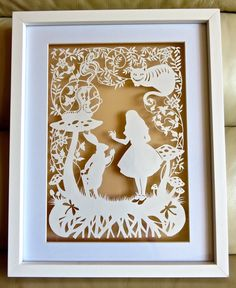 This is my 3rd Alice in Wonderland papercut template from Bramble Crafts.  There are 5 altogether.  I have hand cut it with a scalpel.