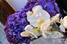 Wedding candles for church with purple hydrangea and white orchids phalaenopsis.