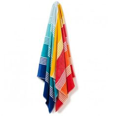 Canningvale Deluxe Cotton Velour Beach Towel - Rainbow Bay. Rainbow Bay offers a fun mix of bright rainbow colours in repeating broad and finer stripes, featuring reds, orange, yellow, aquas and blue.