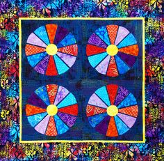 """""""Wagon Wheels"""" is featured in """"Flip & Fuse Quilts"""" book by C&T Publishing with Marcia Harmening of Happy Stash Quilts."""