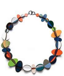 Rebecca Hannon Jewelry - This one is made from interlocking pieces of laminate. But this is a great inspiration piece for a necklace in felt.