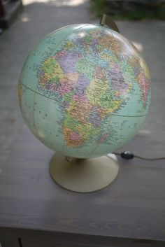 It'd be neat to get a globe-lamp, and then poke tiny holes in all the places you've been :).