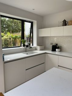 White kitchen refurbishment using our 'Dynamic' range as splashback tiles to create a modern look. Order free samples of our range online. Splashback Tiles, Dynamic Range, Refurbishment, Free Samples, Kitchen Cabinets, Create, Modern, House, Home Decor