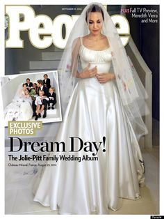 The cover of People showing Brad Pitt and Angelina Jolie with their children on their wedding day. And in a unique and loving touch, Angelina's beautiful wedding gown was partly decorated by their children and looks amazing