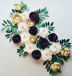 Gorgeous flower wall display in burgundy, gold, white and green colors (measuring about 2 feet on 2 feet), handmade with great care. Available in any size or color upon your request!  LIFE-LIKE breathtaking flowers for special moment... Perfect for wedding backdrop, shop window display, nursery wall decor, etc. Flowers are about 4-5 wide.  Different color options and quantity of flowers are available upon your request.  Listing does NOT include actual wall - flowers will come fully…