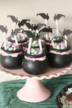 The mini cauldrons full of candy with an upside-down witch sticking out at this . Pink Halloween, Halloween Party Favors, Halloween Party Themes, Halloween Goodies, Halloween Kids, Halloween Treats, Halloween 1st Birthdays, Halloween Birthday, Witch Party