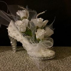Recycled thrift store shoe flower arrangement centerpiece.