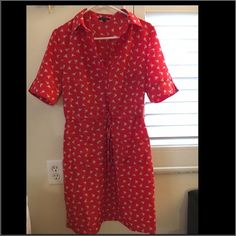 Dress with birds Red/orange knee length, ties at waist. Sleeves to elbow length. Super cute! Like brand new! Always lots of compliments! Spense Dresses Midi