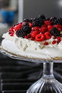 Vanilla Bean Pavlova with Honey Cream and Berries