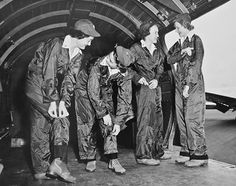 From the group of 500 US Army Air Forces, these flight nurses prepare for a mission. They're arranging their flying suits, because initially, they were required to wear male clothes. Later on, several types of flying clothes for women were developed. Photo circa, 1944 ~