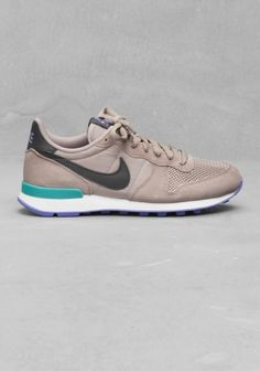 NIKE These sneakers have a retro running shoe style, combining both a suede  and nylon ca13b15786