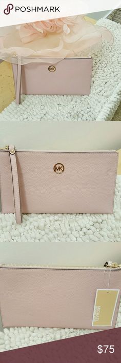 500c6398195c Micheal kors wristlet Authentic Michael Kors wristlet Nwt baby pink with  inside pocket. super soft