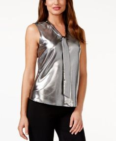 Kasper Tie-Neck Metallic-Silver Top $44.25 Be perfectly polished in this metallic-silver tie-neck top from Kasper for a trendy look on your next night out.