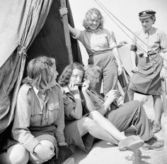 German female prisoners of war outside their tented accommodation in a camp for SS, Luftwaffe and civilian women prisoners at Vilvoorde on the outskirts of Brussels.