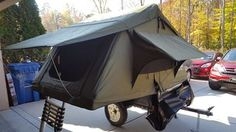 This is Jeffery's scaled down Explorer Box style camping trailer. It is built on a Harbor Freight 40x48 frame. With a weight of about 300 lbs, it is perfect for behind his Hybrid.