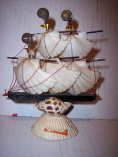 Antique Vintage Nautical Seashell Sailing Ship.  I have this very ship.  I got it from my Grandma.