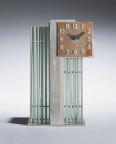 Designed by Jean Puiforcat, these 1930s clocks are the finest examples of French geometric art-deco style.