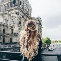 Long blonde ombré, pulled back loose braid