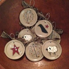This listing is for a set of 4 ornaments. Prim designs to include a sheep, crow, prim star and a willow tree. These have a wire for hanging and are tied with homespun. They are hand painted d sealed with clear coat to protect the paint.