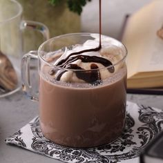 Make the most of those last few drops of wine by making Red Wine Hot Chocolate. This single-serving drink recipe is the ideal nightcap. Make the most of tho Chocolate Videos, Hot Chocolate Recipes, How To Make Chocolate, Chocolate Syrup, Coffee Recipes, Wine Recipes, Peach Daiquiri, Frozen Hot Chocolate, Chocolate Caliente