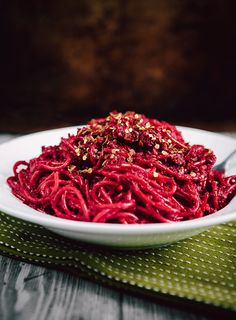 Roasted Beet and Garlic Pasta |Ingredients: 1 pound whole grain spaghetti, 1 1/2 pounds red beets, trimmed and scrubbed, 4 whole garlic cloves, peeled, 1/4 cup olive oil, divided, 1/2 cup toasted walnuts, 2 tablespoons sun dried tomatoes, chopped freshly ground salt, red pepper flakes, 2/3 cup ricotta