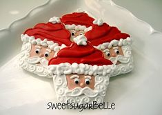 Cute Santa cookies, made with a cupcake-shaped cutter, from Sweet Adventures of Sugarbelle.