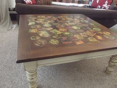 Decoupaged beer labels onto coffee table. Stained, sanded and sealed. I love it!
