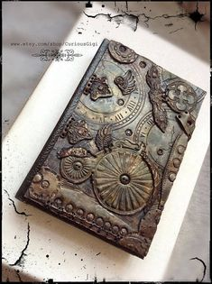 Display Item Hardcover Sketch Book with original steampunk polymer clay art work, blank art book by CuriousGigi on EtsyOriginal Steampunk blank book, MADE TO ORDER gifts, wedding guestbook alternative, one of a kind art giftsWondering what is Steampu Steampunk Book, Steampunk Crafts, Steampunk Wedding, Polymer Clay Steampunk, Polymer Clay Art, Altered Books, Altered Art, Polymer Journal, Blank Book