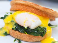 How to Make Eggs Benedict. Eggs Benedict is a classic at Sunday brunch, New Year's morning, or a morning with that special person in your life. The hollandaise sauce can make it or break it. How To Make Eggs, Lemon Muffins, Canadian Bacon, Hollandaise Sauce, Egg Whisk, Cheat Meal, Sunday Brunch, Good Food, Fun Food