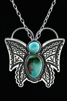 Herman Smith High Grade Royston Turquoise Ingot Butterfly Pin/Pendant | eBay    This gorgeous one of a kind piece hand made by award winning Navajo artist Herman Smith features two exceptional high grade Royston turquoise cabochons. The specimens are an amazing blue-green with chocolate brown matrix. The piece also includes elaborate detail in hand rolled and hammered ingot sterling silver with wonderful oxidation and hand twisted wire.   $400