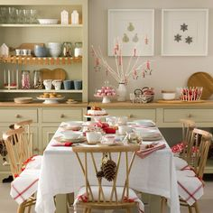 Tie lengths of red ribbon onto metal cookie-cutters and hang them up as decorations on the branches of a mini tree.
