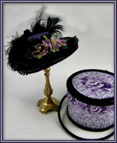 Love this site! Most hats have a matching hatbox and/or accessories (gloves etc.)