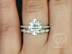 Blake 10x8mm & Christie 14kt White Gold Oval FB Moissanite and Diamonds Cathedral Wedding Set (Other metals and stone options available)