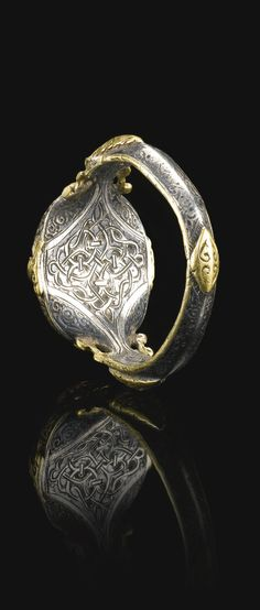A fine and rare Seljuk silver and gold ring set with a deep purple stone seal bearing the name of Ali Ibn Yusuf, Persia, 12th century   | Lot | Sotheby's