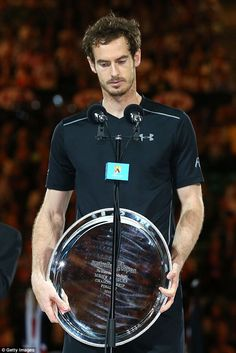 Murray, holding the runners-up plate, spoke of his wife Kim Sears who is home in England awaiting the birth of their first child
