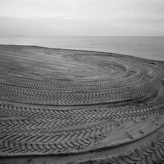 Mark Power. GB. SCOTLAND. Edinburgh. Portobello. Tyre tracks on Portobello beach. 15.12.1994