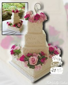 4-tier square fondant wedding cake with scrollwork, dragees, fresh flowers