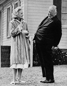 Tippi Hedren and Alfred Hitchcock on the set of The Birds (1963).