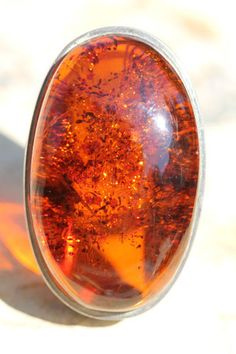 Baltic amber ring.  I Love Amber. It's such a deep, warm, healing material. Great to use to draw radiation away from the body!