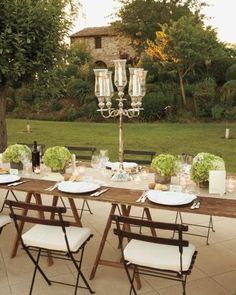 Hydrangeas and tall silver candelabras add elegance to rustic reception tables
