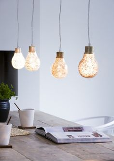 Spray paint light bulbs after placing lace over them.
