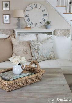 Nice way to stage a coffee table with a wicker tray, books and a cup of flowers.  Love this and love this ladies style, check out her blog and FB pages, great style  Petticoat Junktion