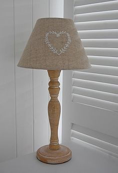 A wooden lamp with heart embroidered lampshade from The White Lighthouse