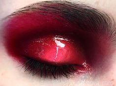 Red, glossy eye.