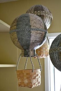 Paper mâché hot air balloons. Fun kids summer craft idea? With cheap baskets from DI maybe?
