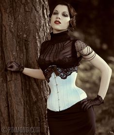 Model: Morgana. Photo by Iberian Black Arts maybe? Corset, Puimond curvy underbust.