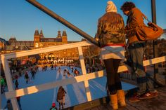 Lovers on a bridge looking at the #Rijksmuseum, skaters and I #AMsterdam!