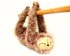 sloth amigurumi plush stuffed animal hanging velcro mink cream brown beige crochet doll ready to ship. $37.99, via Etsy.