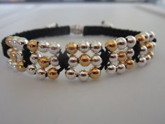 Shamballa Bracelet with metal beads . Gold and Silver metal beads. Love the way this gets put together at the end.